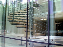 Glass with Spiral Staircase behind