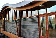 Reclaimed materials forming structure and cladding